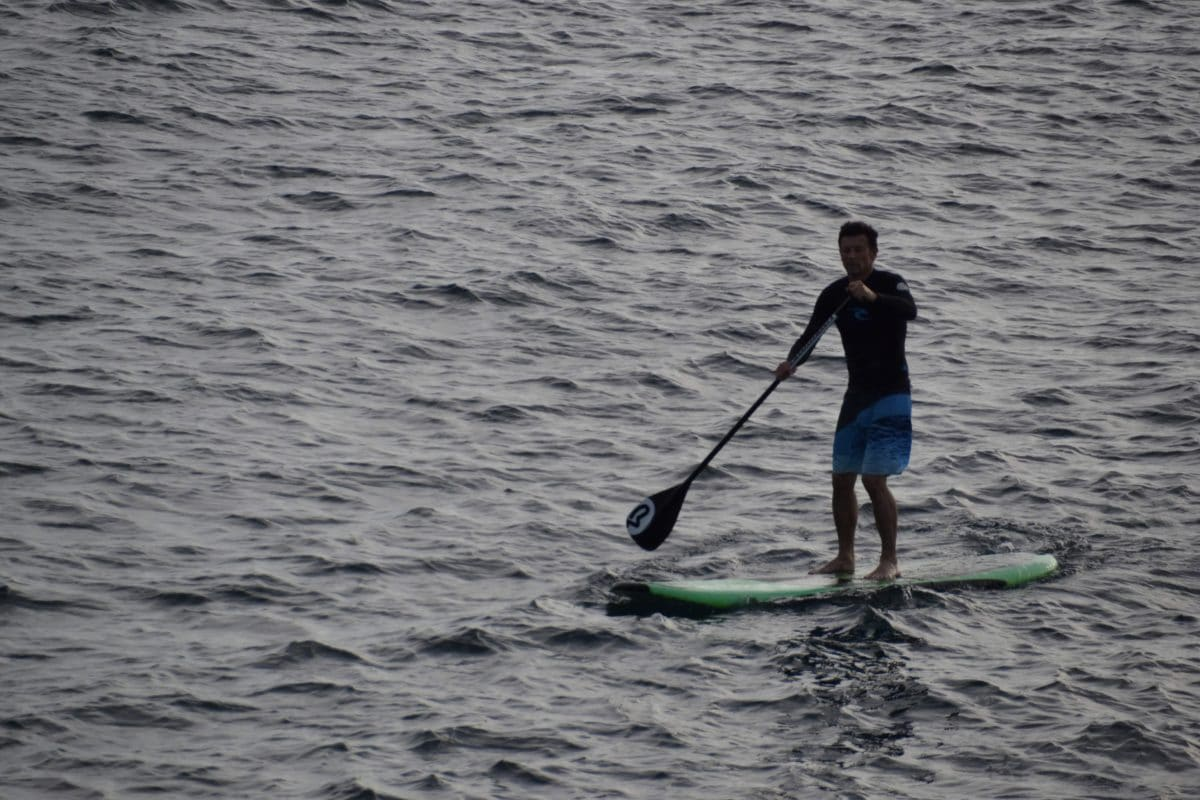 stand up paddle boarding on a lake